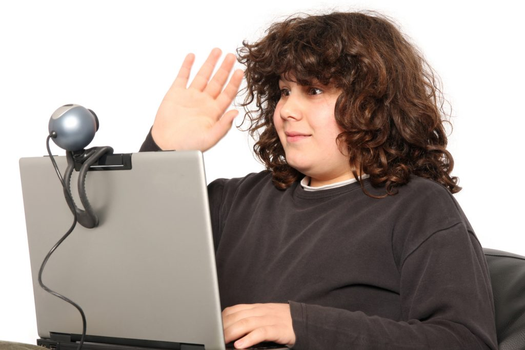 A young boy addressing viewers through his webcam and on his personal vlog.