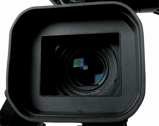 The front view of a camera, ready to shoot a commercial video.