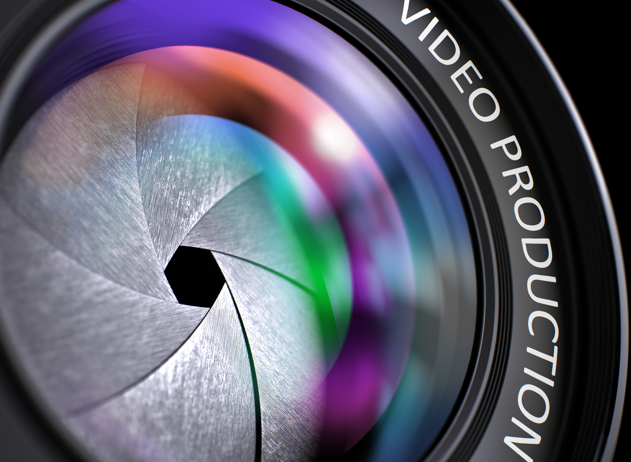 A camera lens with the words video production on it.