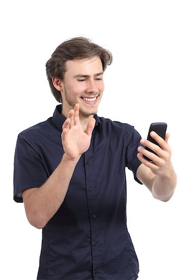 Happy man waving to a smart phone camera shooting vertical video isolated on a white background.