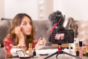 A taste maker on youtube films video testimonials for a makeup brand that will be seen by millions of her fans.